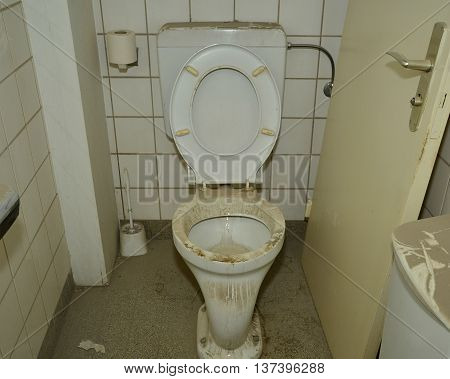 A dirty, dusty, no working toilet in a derelict house
