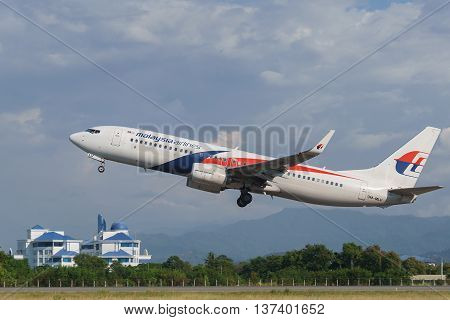 Kota Kinabalu Sabah Malaysia - Feb 22 2016 : Malaysia Airlines Boeing 737-800 taking off at Kota Kinabalu Airport. Malaysia Airlines is Malaysian own by Malaysian government and currently under business restructuring.