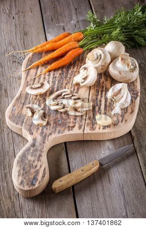 Ingredients for cooking: mushrooms carrots and garlic. Closeup