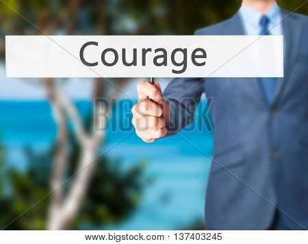 Courage - Business Man Showing Sign