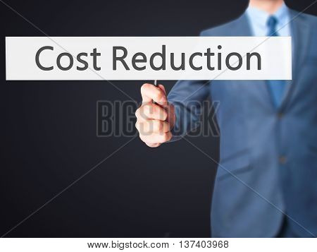 Cost Reduction - Business Man Showing Sign