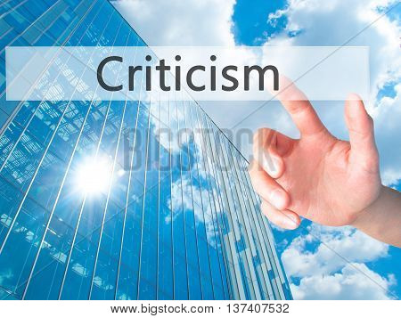 Criticism - Hand Pressing A Button On Blurred Background Concept On Visual Screen.