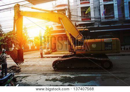 Large excavators Road construction site demolition.backhoe working contractor.Big excavator.