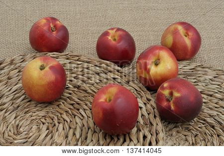 seven nectarines on canvas and on mats