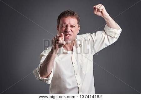 Portrait of a angry middle age man getting fury poster