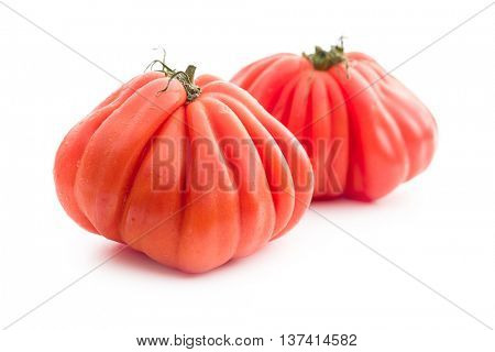 Coeur De Boeuf. Beefsteak tomatoes isolated on white background.