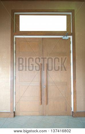 Big wood door indoor at hotel, close door