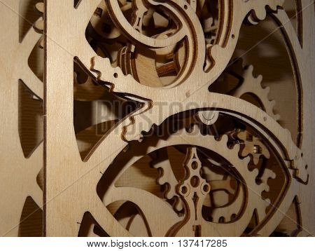 Gears in wooden decoration mechanism closeup stock photo