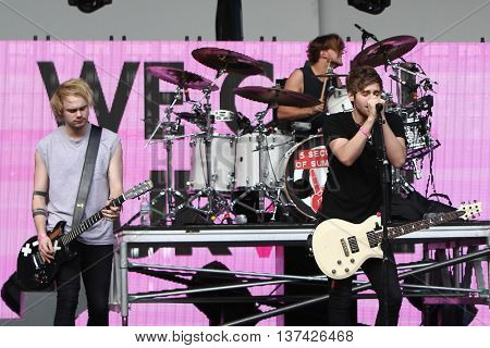 (L-R) Michael Clifford, Ashton Irwin & Luke Hemmings of 5 Seconds of Summer perform before CBS RADIOs third annual We Can Survive at the Hollywood Bowl on October 24, 2015 in Hollywood, California.