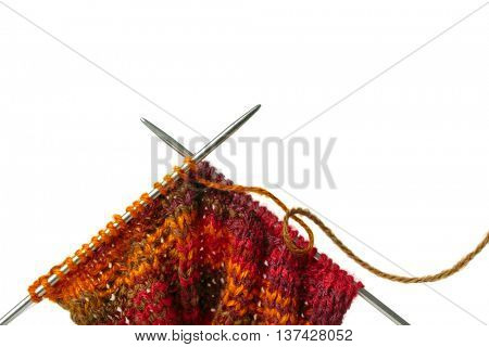 Close up of knitted yarn with a pair of knitting needles