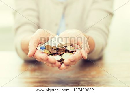 savings, money, annuity insurance, retirement and people concept - close up of senior woman hands holding money jar poster