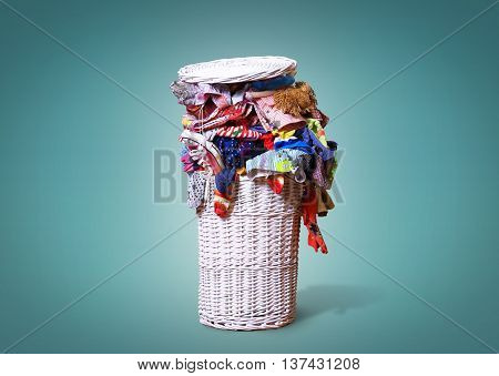 White straw basket full of dirty Laundry