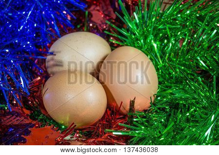 eggs on Christmas background theme. three, color.