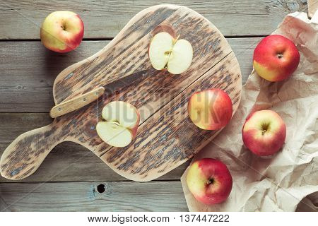 red apples lie on chopping board top view