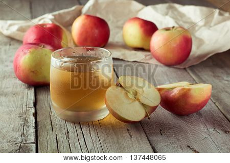 sliced apple and juice in background closeup
