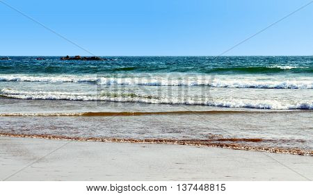 The beautiful beach and stones in the water