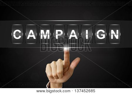 business hand pushing campaign on Flipboard Display
