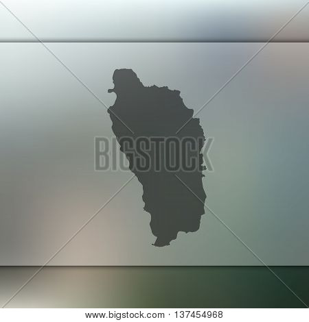 Dominica map on blurred background. Blurred background with silhouette of Dominica. Dominica.