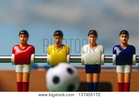 foosball table soccer football players blue sky