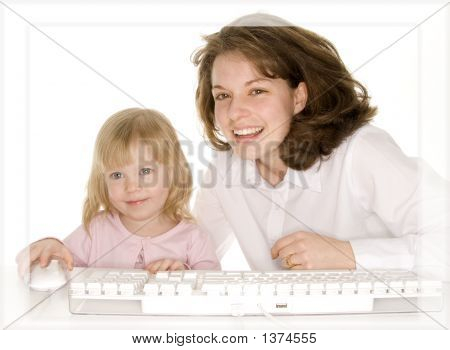 Mother Having Fun With Daughter On Computer