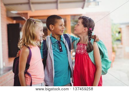 Three kids with arms around each other during the recreation