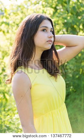 14 year old girl looking up outdoors on a sunny day