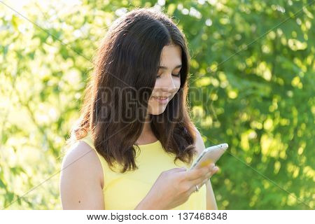 14 year old girl reads sms on phone