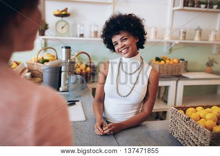 Juice Bar Owner Talking With Female Customer