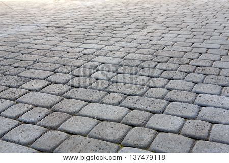 Stone paving texture. Abstract structured background of modern street pavement slabs pattern, selective focus