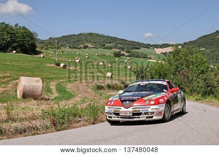 TREDOZIO FC ITALY: driver and co-driver on a sports car Alfa Romeo GTV V6 TB traveling in the hills during the rally
