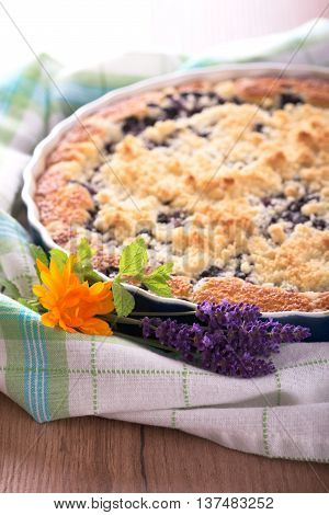 Bunch Of Lavender Blooms And Marigold In Front Of Berry Pie