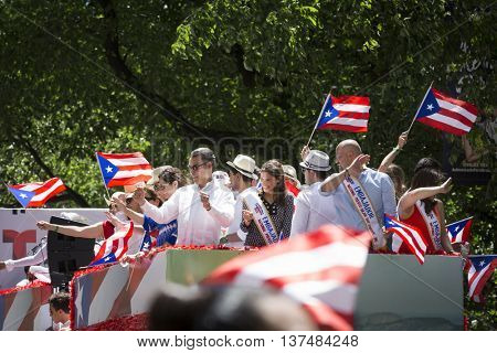 NEW YORK - JUNE 12 2016: Parade Honorees celebrate from the Telemundo float during the 59th annual National Puerto Rican Day Parade on 5th Avenue in New York City on June 12 2016.