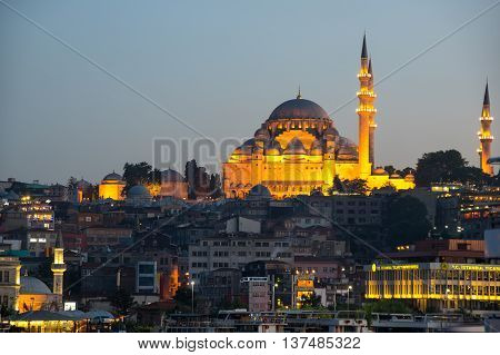 ISTANBUL TURKEY - JUNE 20 2015: Night view on the Suleymaniye Mosque and Eminonu district Istanbul Turkey