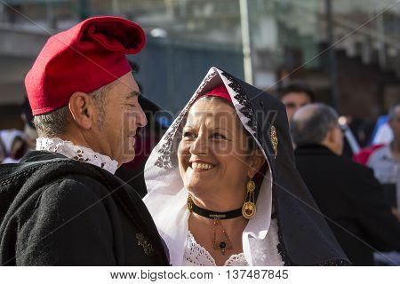 CAGLIARI, ITALY - May 1, 2015: 359 ^ Religious Procession of Sant'Efisio - Sardinia - couple smiling spouses in traditional Sardinian costume
