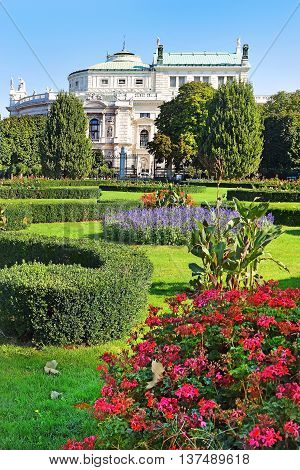 People's Garden (Volksgarten, 1821) - public park in Inner Stadt Vienna, Austria. Garden is part of Hofburg Palace, was laid out by Ludwig Remy, Burgtheater in the background