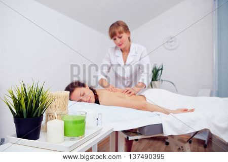 Luxury massage from gentle hands in spa salon.
