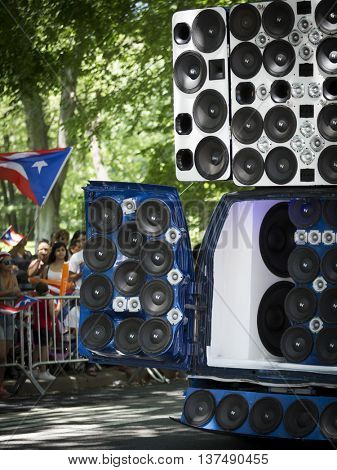 NEW YORK - JUNE 12 2016: A van modified with dozens of speakers amplify music to celebrate the 59th annual National Puerto Rican Day Parade along 5th Avenue in New York City on June 12 2016.