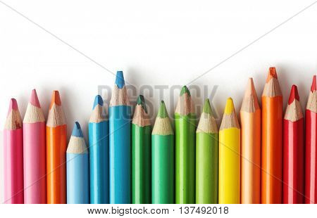 colorful crayons isolated on white background