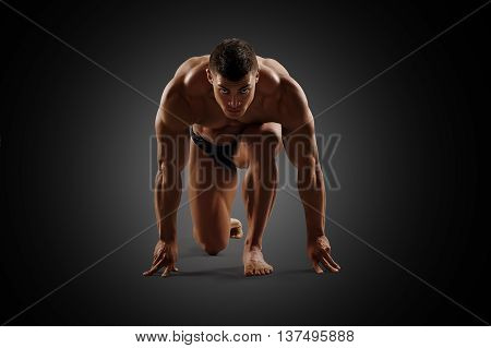 Muscular sexy naked man ready to run