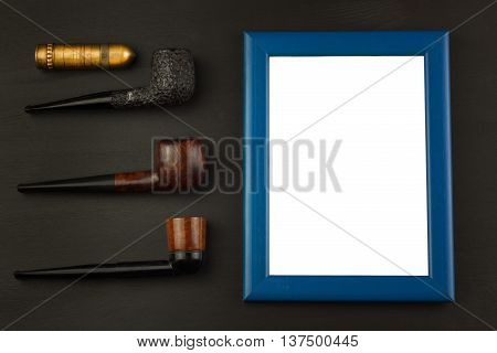 Photo picture frame on black wooden background.