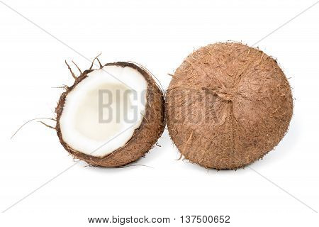 Whole hairy coconut and near half a coco isolated on a white background