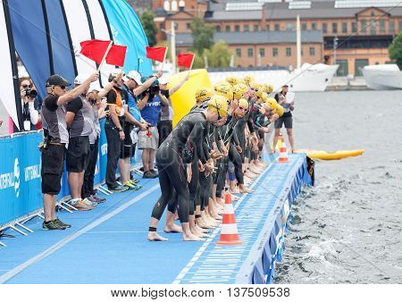 STOCKHOLM - JUL 02 2016: The woman swimmers just before the start signal in the Women's ITU World Triathlon series event July 02 2016 in Stockholm Sweden