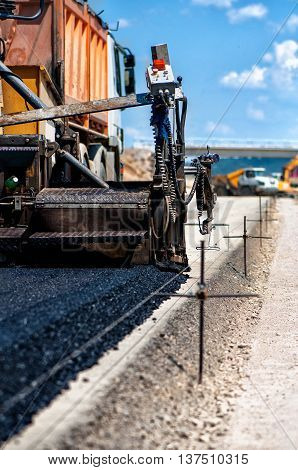 Industrial Pavement Truck Or Machine Laying Fresh Bitumen And As