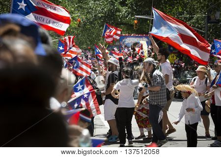 NEW YORK - JUNE 12 2016: Musicians celebrate in the street during the 59th annual National Puerto Rican Day Parade on 5th Avenue in New York City on June 12 2016.