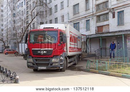 Nizhny Novgorod Russia. - April 14.2016. Cargo fura drove backwards to the rear entrance of the store MAGNET unloading goods. Street Sovnarkomovskaya 26.