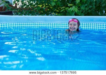 Laughing Little Girl In A Swimming Pool