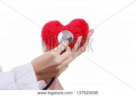 Medical examination of cardiology. Hands of cardiologist with heart and stethoscope. Female doctor makes measurement heartbeat. Isolated on white.