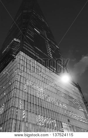 NEW YORK CITY June 22: A night view of the Freedom Tower One World Trade Center looking up at the facade in black and white illuminated by a street lamp. MANHATTAN NEW YORK JUNE 22 2016..