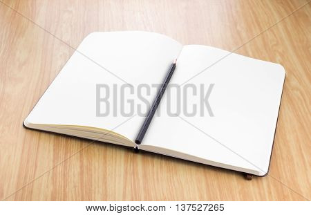 Blank Open Notebook With Black Pencil On Wood Table,business Template Mock Up For Adding Your Text