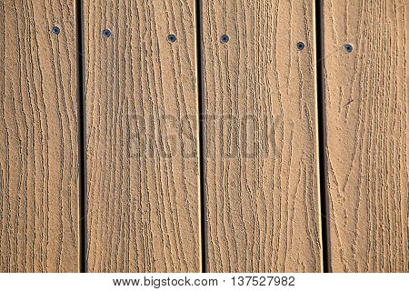 Wooden planks with screws for background use.